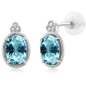10K White Gold Diamond Earrings Set with Oval Ice Blue Topaz from Swarovski
