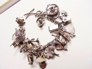 VINTAGE STERLING SILVER CHARM BRACELET   LOADED!!