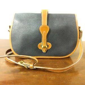 Dooney amp; Bourke vintge navy and tan Over and Under Bag pre loved $68.00