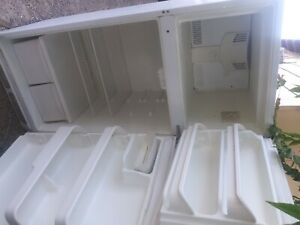Frigidaire Refrigerator White freezer works great keeps food cold pick up avai.