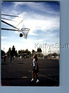 FOUND COLOR PHOTO Y0666 PRETTY WOMAN IN SKIRT POSED UNDER BASKETBALL HOOP $7.98