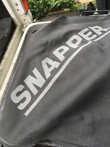 SNAPPER BAG AND DISCHARGE CHUTE