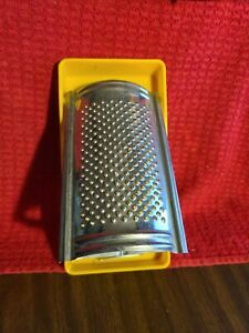 Stainless Steel Flat Grater in yellow plastic holder. SS Hong Kong