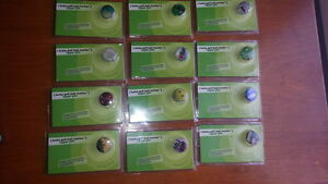 12 LAPEL PINS Golf ball markers. UNIQUE. Brand new in original package.