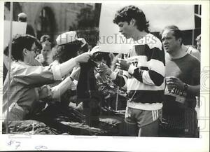 1985 Press Photo Boy receiving his T-shirt for running Bloomsday race