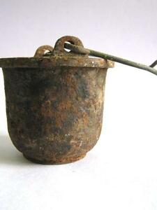 ANTIQUE CAST IRON UTENSIL USED FOR MELTING LEAD .