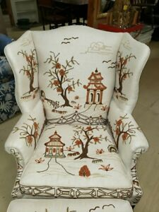 VINTAGE KINDLE WINGBACK CHAIR AND OTTOMAN WITH HAND STITCHED CREWEL WORK DESIGN.