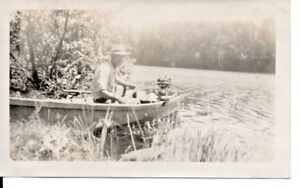 Man Fishing In A Boat With A Small Outboard Motor Photo 1940s