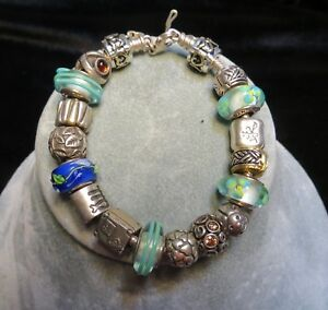 Authentic Pandora Sterling Silver Bracelet with Authentic Retired Pandora Charms