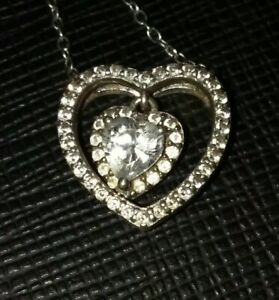 925 Sterling Silver Triple Heart Pendant. Beautiful cz around the outside.