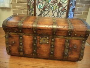 Solid wood antique trunk or chest metal bands 29.5 inches long curved top $395.00