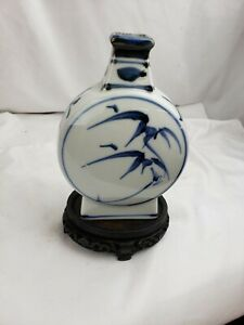 Superb vintage blue and white porcelain bottle with antique stand $47.19