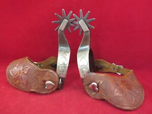 PAIR OF KELLY MARKED ARROW HEART SPURS WITH STRAPS