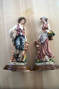 pair of large style figurines signed by a belcari