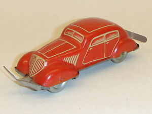 german tin litho windup toy car red 4 door sedan