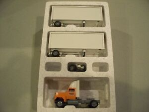yellow doubles tractor trailer diecast