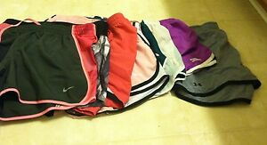 WOMEN'S LOT OF 7 NIKE AND UNDER ARMOUR UMBRO AVIA ATHLETIC SHORTS SIZE MEDIUM