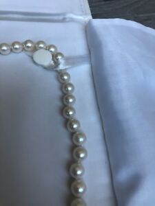 fresh water pearl necklace and pearl earring set with gold attachments