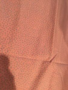 Pink fabric with small white dots BTY