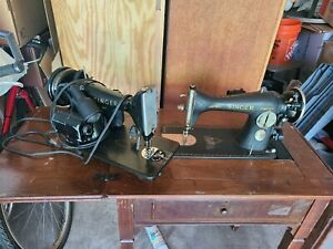 Vintage Singer Sewing Machines And Table $99.00