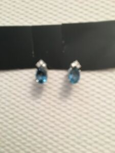 14k Gold And London Blue Topaz Earrings Each With 3 Diamonds