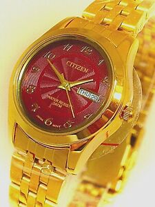 Vintage citizen ladies watch gold tone red dial .