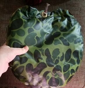 ORANGE SEAT ONE SIDE GREEN CAMOUFLAGE ON REVERSE SIDE HUNTING FISHING OUTDOORS