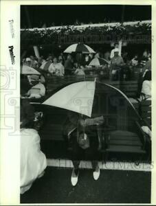 1992 Press Photo Unidentified woman sits under large umbrella at Saratoga Track $12.99