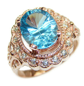 Fancy Swiss Blue Topaz 18k Gold over .925 Sterling Silver handcrafted ring size $474.38