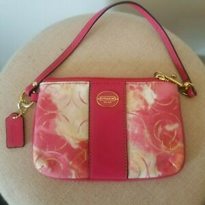 Coach pink fabric and leather wristlet. New 100 100
