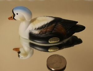 VINTAGE HERTERS INC MINI PORCELAIN DUCK 4 INCHES LONG WITH ORIGINAL STICKER
