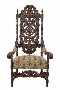 LATE 19TH CENTURY CARVED WALNUT CAROLEAN DESIGN ARMCHAIR