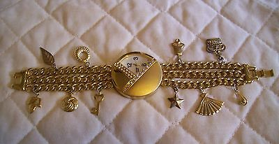 Futura Gold Tone Large Round Watch with Charm Bracelet Chain Band
