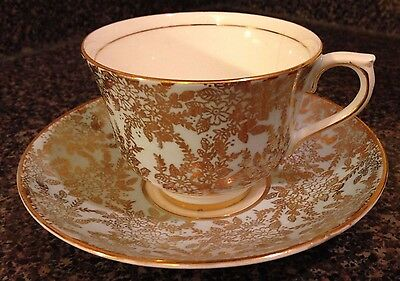 crack on cup Colclough England gold filigree on green bone china cup and saucer