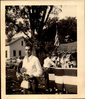 Original photograph 1940s Fourth of July Festival Man Holding Purse