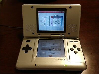 NINTENDO DS ORIGINAL SYSTEM SILVER Case charger and games included-