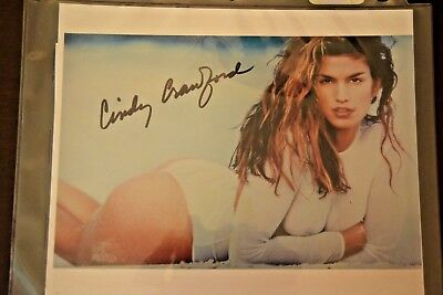 CINDY CRAWFORD AUTOGRAPHED 8 X 10 PHOTOGRAPH WITH CERTIFICATE OF AUTHENTICATION