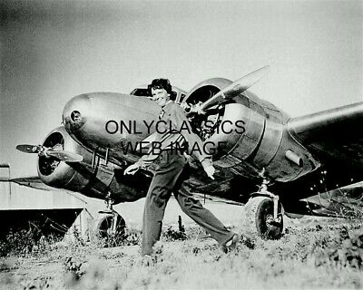 AMELIA EARHART STRUTTING IN FRONT OF TWIN ENGINE AIRPLANE PHOTO AVIATION PIONEER