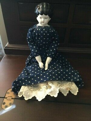 VINTAGE PRIMITIVE CHINA DOLL WITH HANDMADE CLOTHING