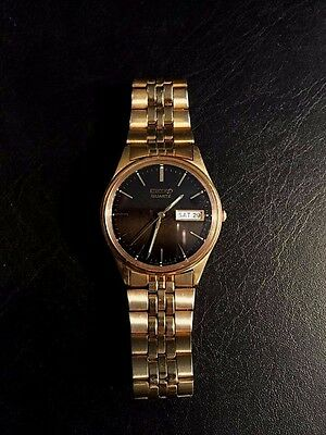 Vintage Seiko Quartz Gold plated stainless steel watch Black face