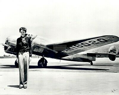 AMELIA EARHART PILOT STANDS IN FRONT OF LOCKHEED ELEKTRA - 8X10 PHOTO EP-639