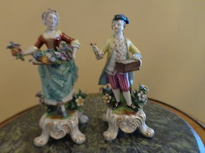 Pair of  Antique Porcelain figurines of a Male and Femael Flower Sellers