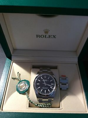 Rolex Oyster Perpetual 39mm Model 114300 - Black Dial