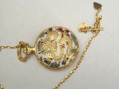 a vintage manual wind hunter pocket watch with cloissonne case front