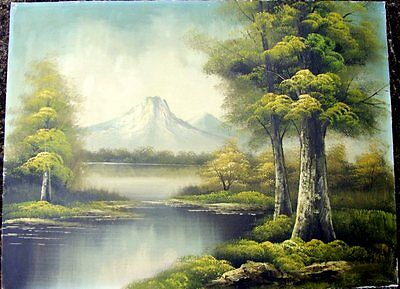 Unframed signed oil on canvasboard of a mountain and lake scene