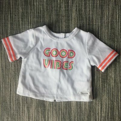 American Girl A white tee with a bright good vibes graphic at the chest