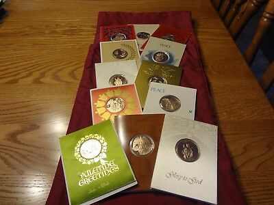 Franklin Mint Christmas cards with CoinsMedals 1968- 1974-  12 in the lot