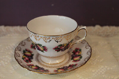 COLCLOUGH ENGLAND TEA CUP AND SAUCER - FRUIT DESIGN TRIMMED IN GOLD