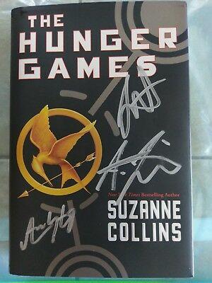 The Hunger Games 1st Edition - SIGNED- Jennifer Lawrence - 3 other cast members