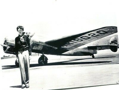 POSTCARD OF VINTAGE PHOTOGRAPH OF AMELIA EARHART STANDING IN FRONT OF HER PLANE
